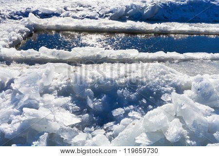 Broken Ice Blocks And Ice-hole In Frozen Rive