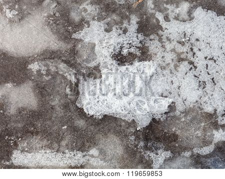 Ice Crust On Frozen Puddle