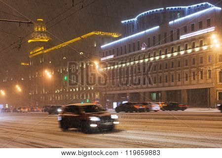Car Driving In Snowfall In City