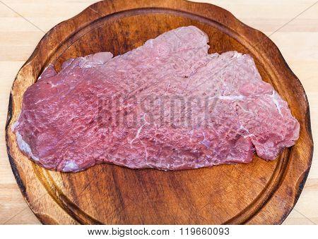 Top View Of Beaten Piece Of Meat