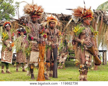 Village tribe dance with drums in PNG