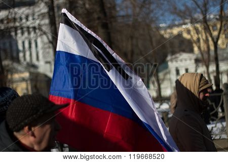 Mourning Russian flag on the March in memory of Nemtsov