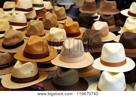 Hats in outdoor store stacked in a row