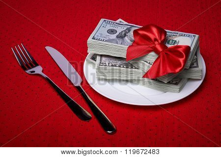 Dollars On A Plate And Cutlery