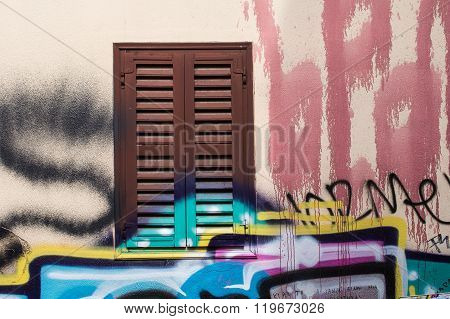 Window With Shutter And Colorful Graffiti