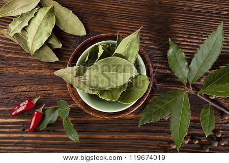 Bay Leaves, Spice And Condiments Wooden Background.
