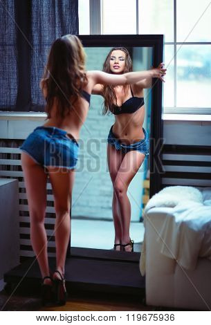 Portrait Of Beautiful Sexy Young Woman Looking Into Mirror