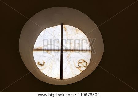 alabaster round window with cross difussed light for churches in Spain