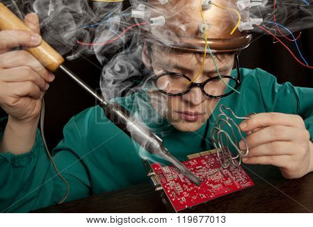 Crazy inventor with soldering iron
