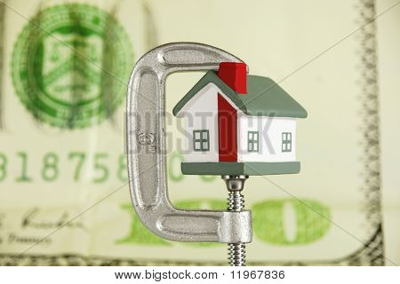 Grip holding a house portraying the housing market