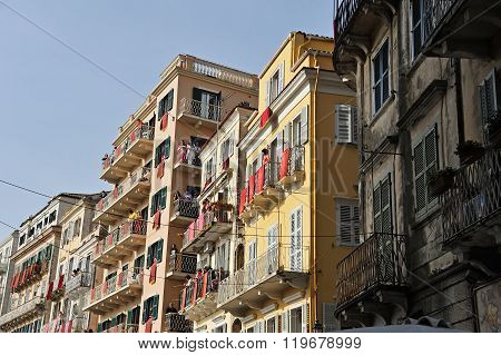 Buildings With Red Banners In Corfu