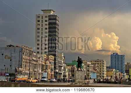 HAVANA,CUBA-JULY 03,2015:People and cars on the Malecon.View of the streets and houses of Old Havana