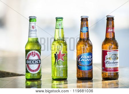 Key West, Florida, USA - January 08, 2016: Popular four bottle of assorted cold beers including Beck's, Heineken, Bud Light and Budweiser horizontal picture.