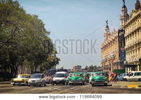 HAVANA,CUBA-JUNE 29,2015: People and American vintage cars in the streets of Havana near the Capitol