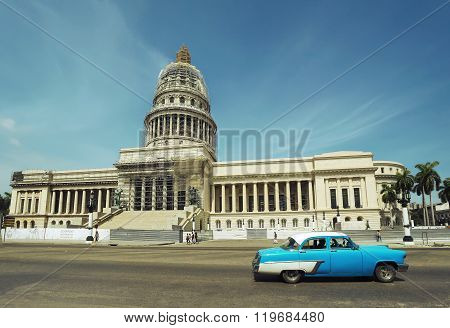 HAVANA, CUBA - June 29, 2015: Old classic american blue car on the background of the Capitol