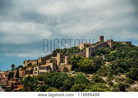 Capdepera castle on green hill in Mallorca