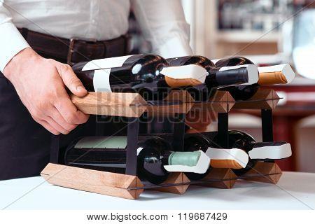Professional sommelier holding wine holder