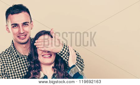 Man Covering Woman Eyes For Surprise.