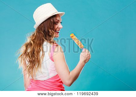 Woman In Summer Hat Eating Ice Pop Cream