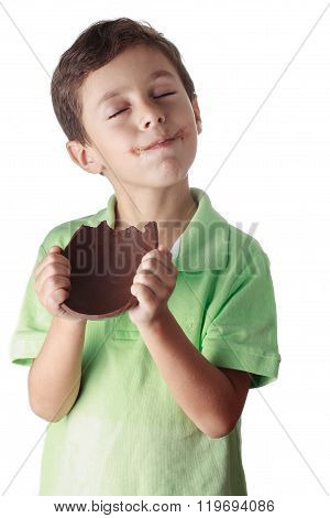 Little Boy Eating Chocolate Easter Egg On White Background