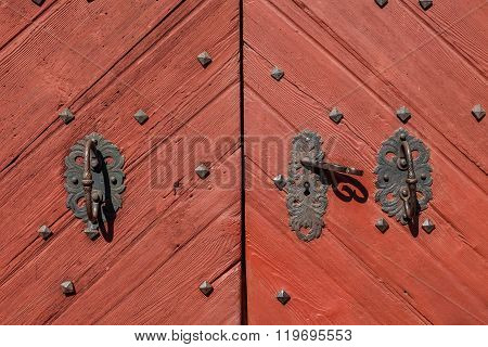 Old wooden door at village church of Steinhaus (Cadipeitra) in South Tyrol Italy