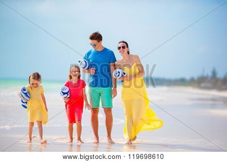 Young family with towels on vacation