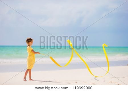 Adorable little girl dancing with with gymnastic ribbon