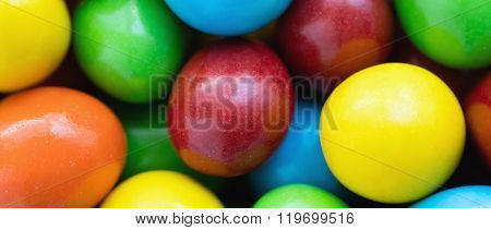 Colorful Background Of Assorted Rainbow Choco Coated  Peanut