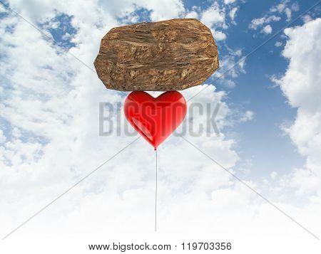 3d heart balloon carrying a rock