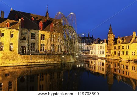 House and canals in Bruges. Bruges Flemish Region Belgium