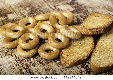 Bagels And Rusks Horizontally On Background Of Wood.