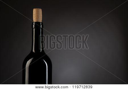 Wine Bottle On Dark Studio Background