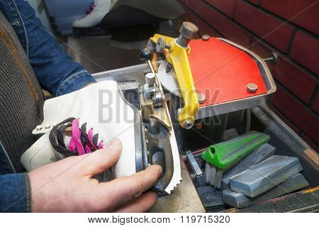 Figure Ice Skate Getting Sharpened