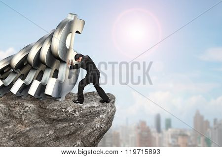 Businessman Stopping Falling Dollar Currency Symbols With Concrete Wall