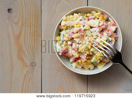 Salad with crab sticks and sweet corn