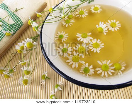 Bath essence with chamomile flowers