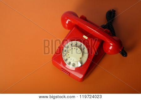 Red Vintage Phone On A Orange Background