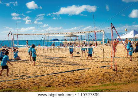 Kids playing beach volleyball, Waikiki Beach Area.