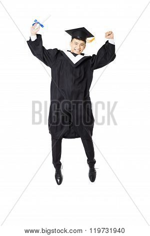 Happy Young Male College Graduation  Jumping