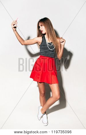 The marine style girl and mobile phone