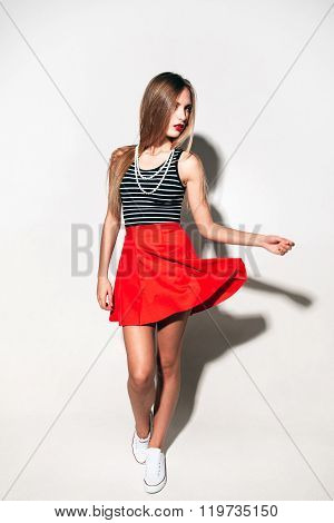 Fashion urban girl in bright red skirt