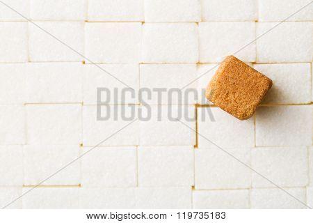 the brown cane sugar cube on white sugar cubes