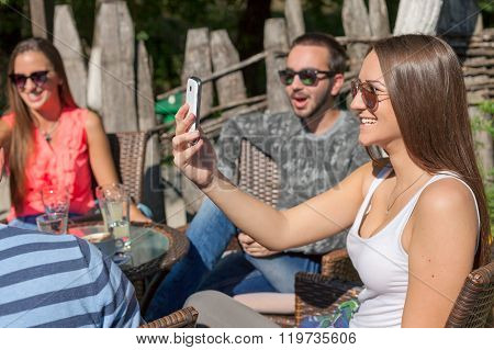 Young Friends Laughing And Taking Picture Outdoor