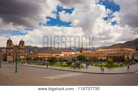 People On Main Square At Dusk In Cusco, Peru