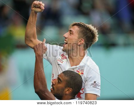 VIENNA, AUSTRIA - SEPTEMBER 28, 2014: Alan (#27 Salzburg) and Kevin Kampl (#44 Salzburg) celebrate after scoring a goal in an Austrian soccer league game.