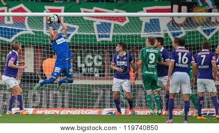 VIENNA, AUSTRIA - NOVEMBER 9, 2014: Heinz Lindner (#13 Austria) catches the ball in an Austrian soccer league game.