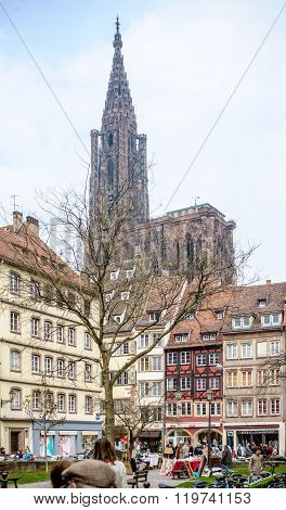 City Of Strasbourg With Tourists Admiring The City And Cathedral