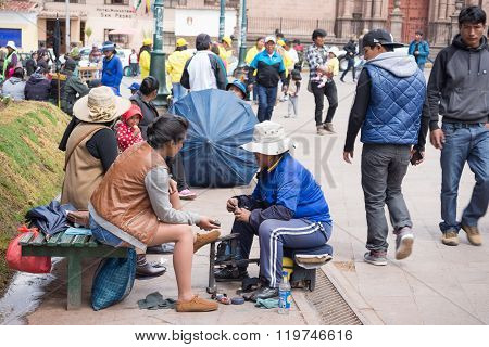Shoeshiner Working In Cusco Street, Peru