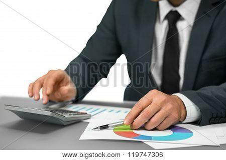 Businessman makes calculations.