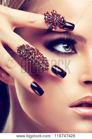 Blonde model with burgundy manicure nails